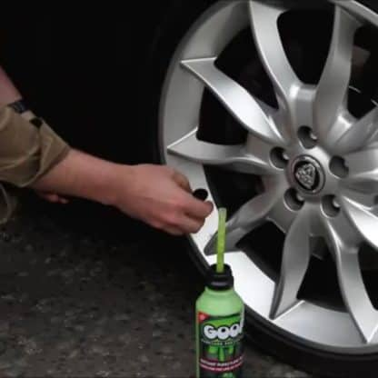 Removing a Tyre Valve Before Installing Goop in a Car Tyre