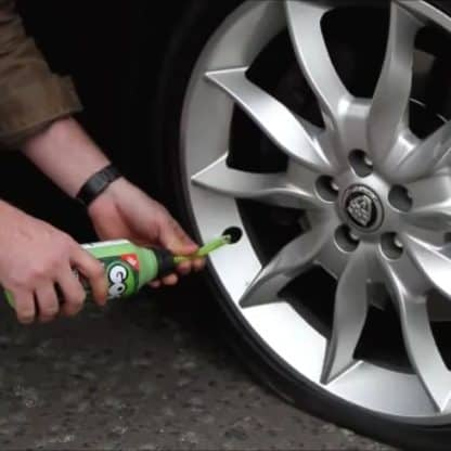 Adding Goop Puncture Preventative to a Car Tyre
